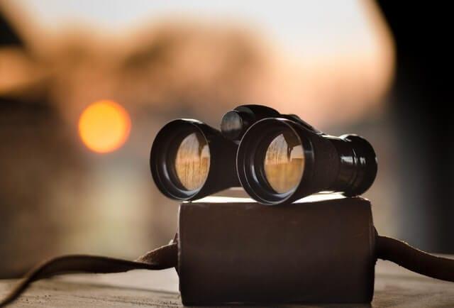 Binoculars on a book